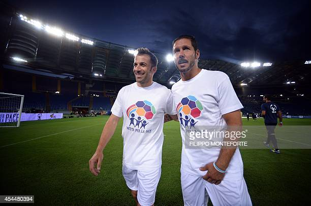 Italy's foward Alessandro Del Piero and Argentine midfielder and Atletico Madrid's coach Diego Pablo Simeone arrive for the inter religious match for...