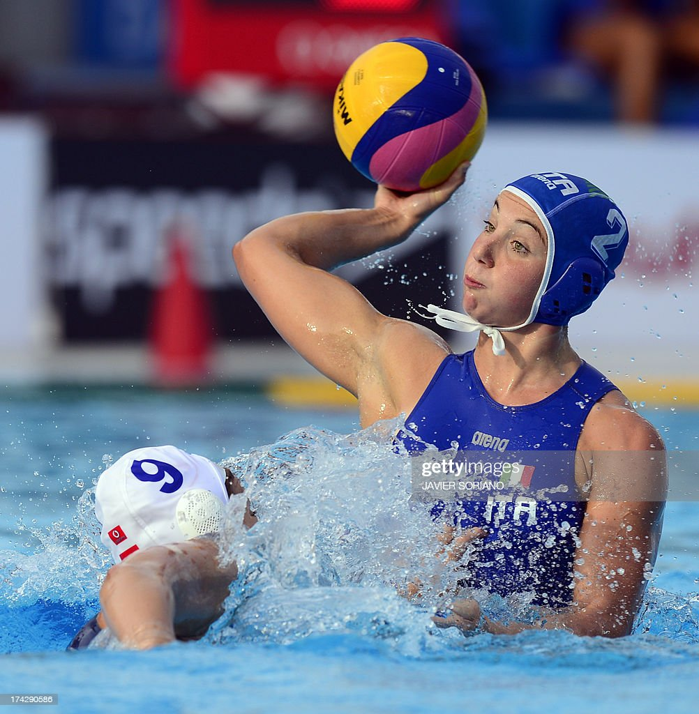 Italy's Francesca Pomeri (R) vies with Hungary's Ildiko Toth (L) during their preliminary round match Hungary vs Italy of the women's water polo competition at the FINA World Championships in Bernat Picornell pools in Barcelona on July 23, 2013.
