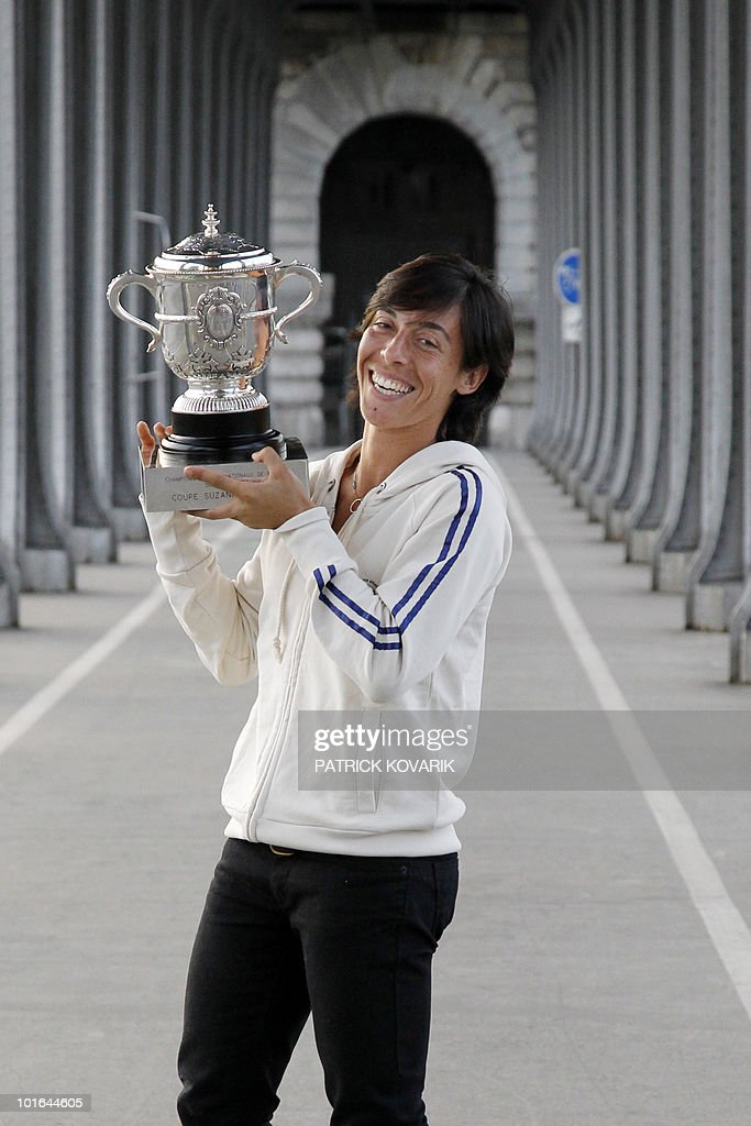 Italy's Francesca Schiavone poses with her trophy at Bir Hakeim bridge in Paris after she defeated Australia's Samantha Stosur in their French Open tennis championship women's final match at the Roland Garros stadium on June 5, 2010 in Paris. Schiavone won 6-4, 7-6.