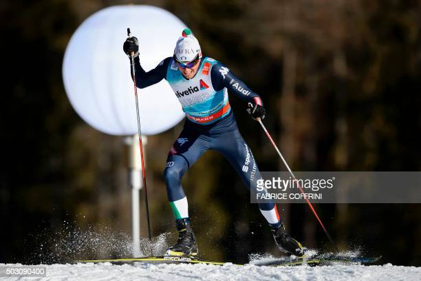 Italy's Francesco de Fabiani competes in the men's 15 km sprint free qualifications at the Tour de Ski event on January 1 2016 in Lenzerheide / AFP...