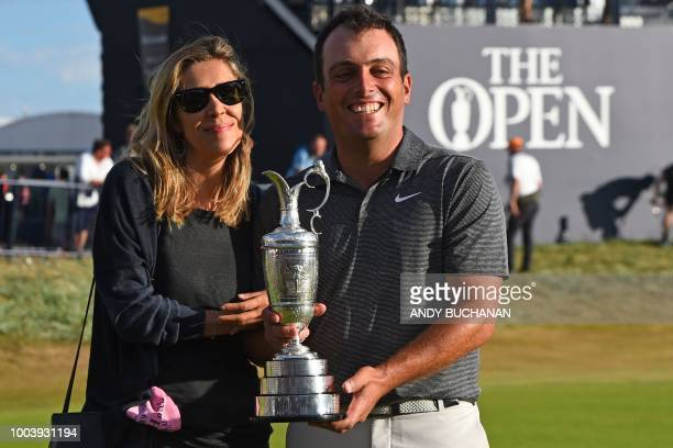 Italy's Francesco Molinari and his wife Valentina pose for pictures with the Claret Jug the trophy for the Champion golfer of the year after...