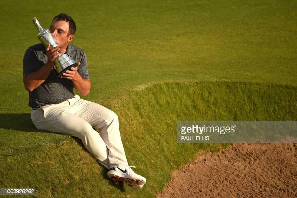 TOPSHOT Italy's Francesco Molinari kisses the trophy as he poses for pictures with the Claret Jug the trophy for the Champion golfer of the year...