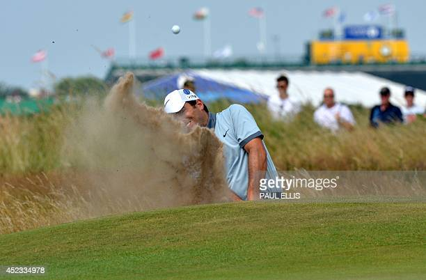 Italy's Francesco Molinari plays from a bunker on the 8th green during his second round on day two of the 2014 British Open Golf Championship at...