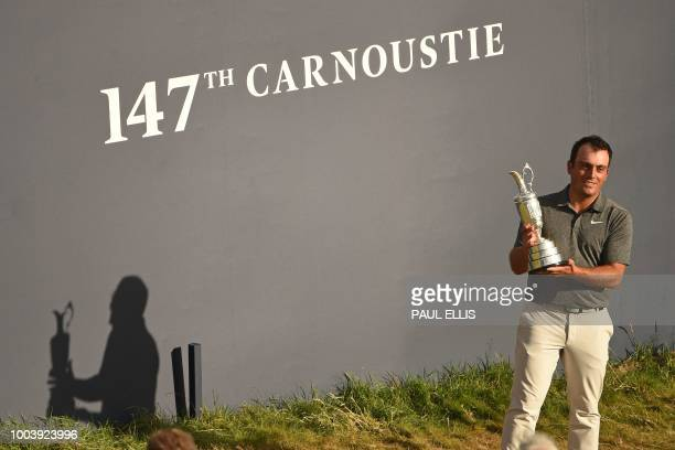 TOPSHOT Italy's Francesco Molinari poses for pictures with the Claret Jug the trophy for the Champion golfer of the year after winning the 147th Open...