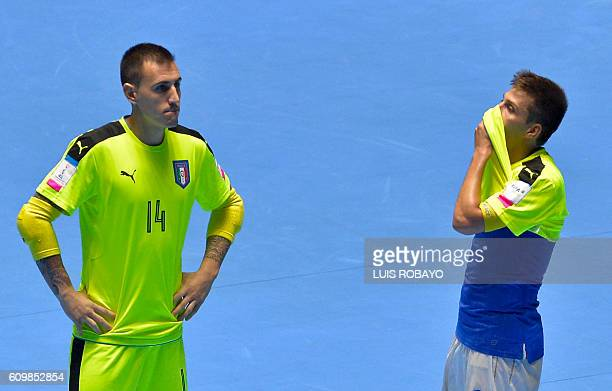 Italy's Francesco Molitierno and Gabriel Lima reacts after losing to Egypt during their Colombia 2016 FIFA Futsal World Cup match at the Coliseo El...