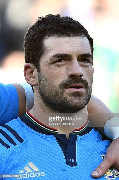 Italy's fullback Andrea Masi listens to the national anthems prior to the Six Nations international rugby union match between Italy and Ireland on...