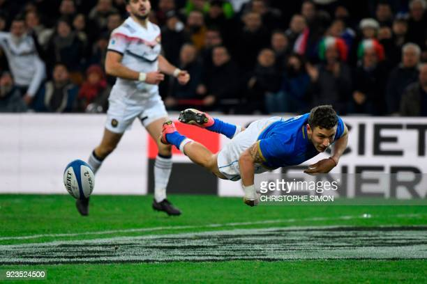 TOPSHOT Italy's fullback Matteo Minozzi scores a try during the Six Nations international rugby union match between France and Italy at the Velodrome...