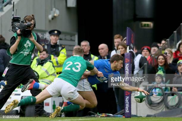 TOPSHOT Italy's fullback Matteo Minozzi scores their third try during the Six Nations international rugby union match between Ireland and Italy at...