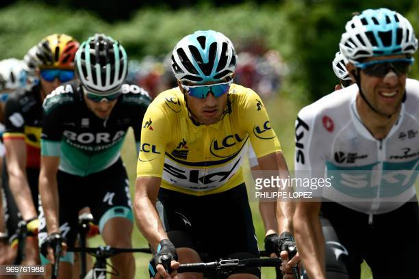 Italy's Gianni Moscon wearing the overall leader's yellow jersey rides at the lead of the pack chasing an eightmen breakaway during the fifth stage...
