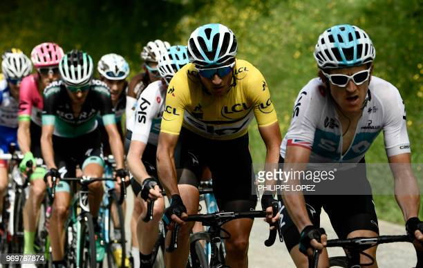 Italy's Gianni Moscon wearing the overall leader's yellow jersey rides with his Great Britain's Team Sky cycling team partners in the last ascent to...