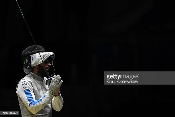 Italy's Giorgio Avola reacts as he competes against US Alexander Massialas during their mens individual foil quarter-final bout as part of the...