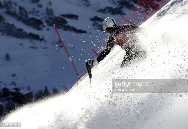 Italy's Giulano Razzoli clears a gate during the first run of the men's slalom at the FIS Ski World Cup on December 15 2013 in Val d'Isere French...
