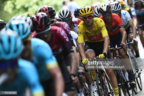 Italy's Giulio Ciccone wearing the overall leader's yellow jersey rides in the pack during the eighth stage of the 106th edition of the Tour de...