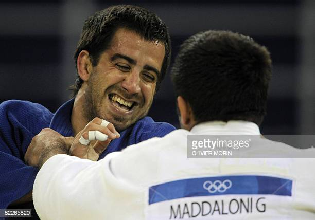 Italy's Giuseppe Maddaloni and Puerto Rico's Abderraman Brenes la Roche compete during their men's 81kg judo match of the 2008 Beijing Olympic Games...