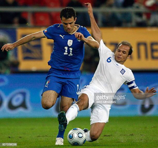 Italy's Giuseppe Rossi fights for the ball with Angelos Basinas during their friendly football game at the Karaiskaki stadium in Piraeus near Athens...