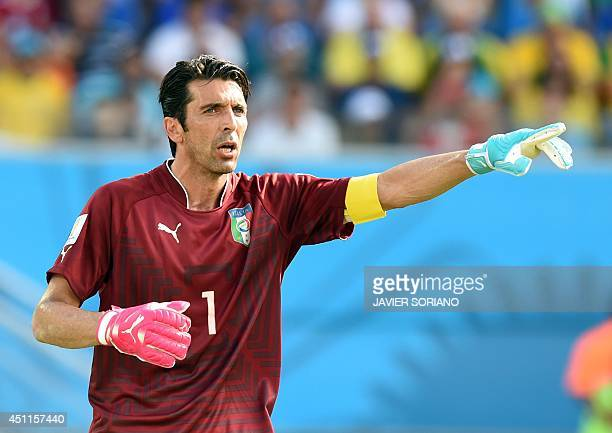 Italy's goalkeeper and captain Gianluigi Buffon reacts during a Group D football match between Italy and Uruguay at the Dunas Arena in Natal during...