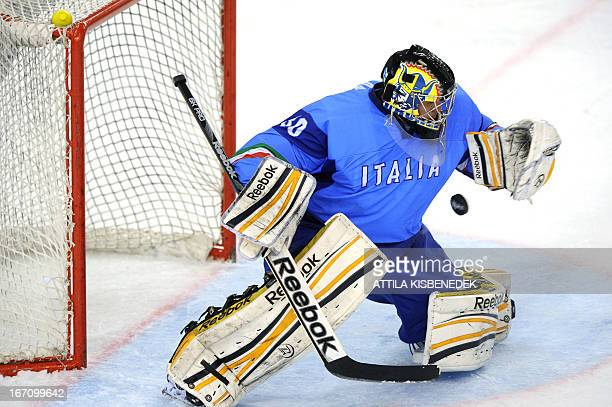 Italy's goalkeeper Andreas Bernard saves the puck against Kazakhstan during the 2013 IIHF Ice Hockey World Championship Division I Group A match...