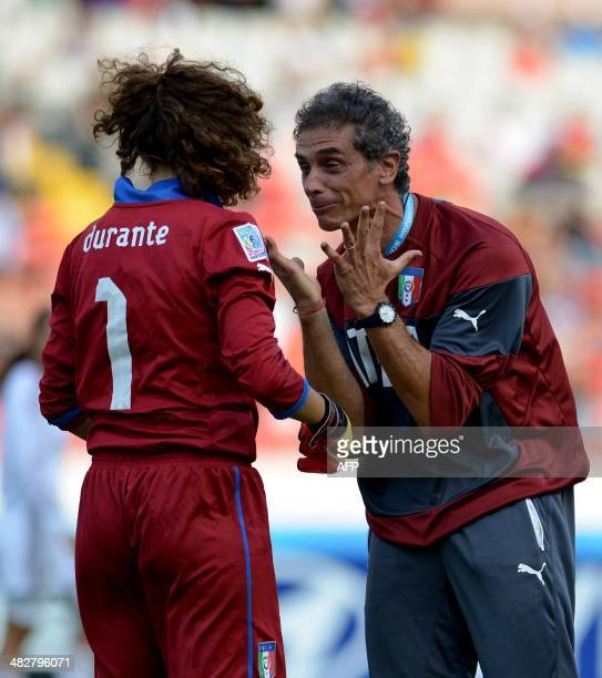 Italy's footballer Italia Francesca Dorante and coach Kenneth Zseremeta celebrate after defeating Venezuela in their FIFA U17 Women's World Cup Costa...