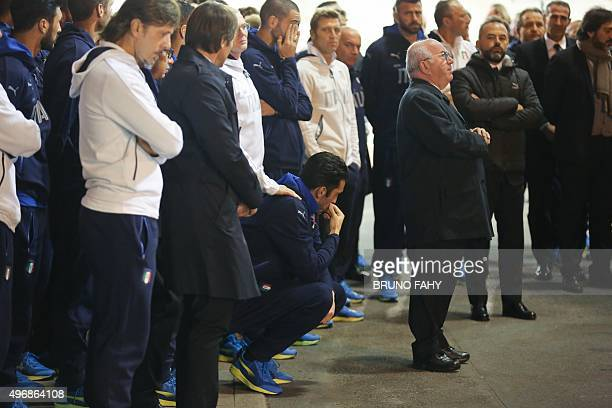 Italy's goalkeeper Gianluigi Buffon and Italy's players attend a commemoration ceremony of the Heysel stadium disaster 30 years ago, in Brussels'...