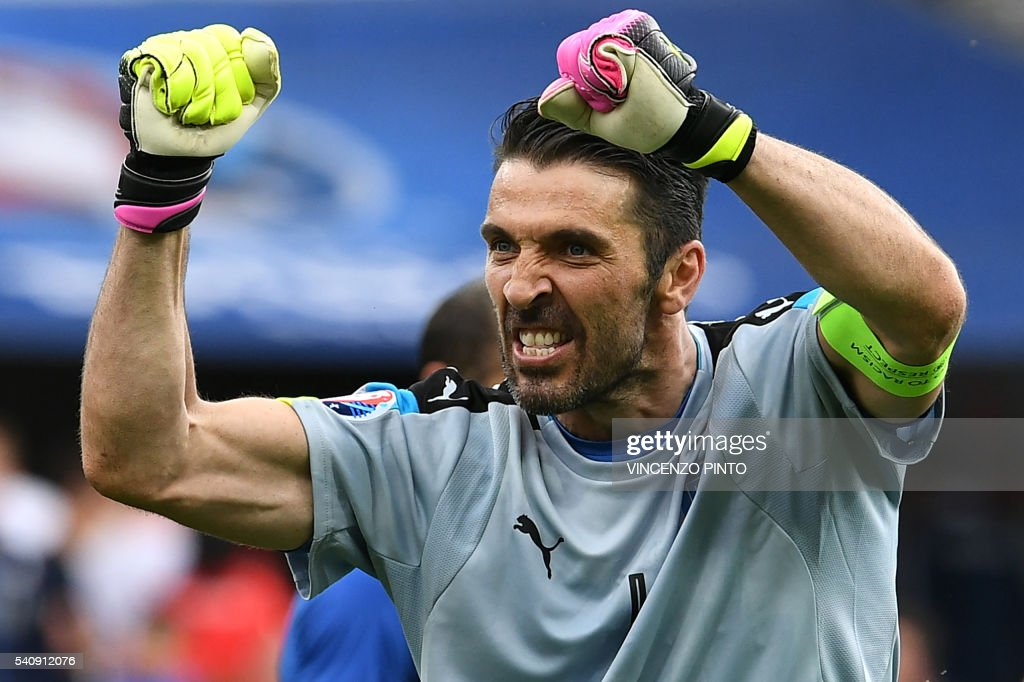 TOPSHOT - Italy's goalkeeper Gianluigi Buffon celebrates after the Euro 2016 group E football match between Italy and Sweden at the Stadium Municipal in Toulouse on June 17, 2016. Italy won the match 1-0. /