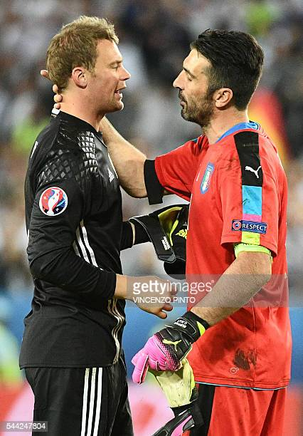 Italy's goalkeeper Gianluigi Buffon congratulates Germany's goalkeeper Manuel Neuer after Germany won the match in nine penalty shoot-outs in the...
