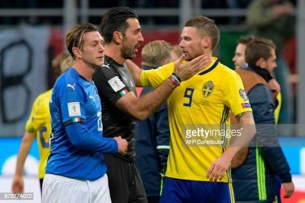 Italy's goalkeeper Gianluigi Buffon congratulates Sweden's forward Marcus Berg at the end of the FIFA World Cup 2018 qualification football match...