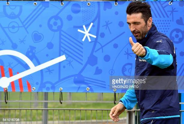 Italy's goalkeeper Gianluigi Buffon gives a thumbsup as he arrives for a training session in Montpellier on June 18 2016 during the Euro 2016...