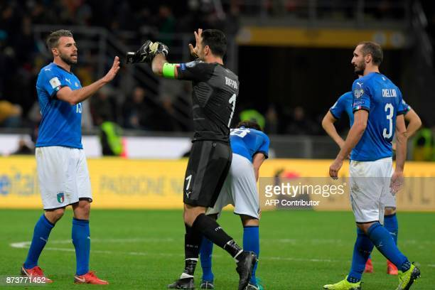 Italy's goalkeeper Gianluigi Buffon Italy's defender Andrea Barzagli and Italy's midfielder Giorgio Chiellini react at the end of the FIFA World Cup...