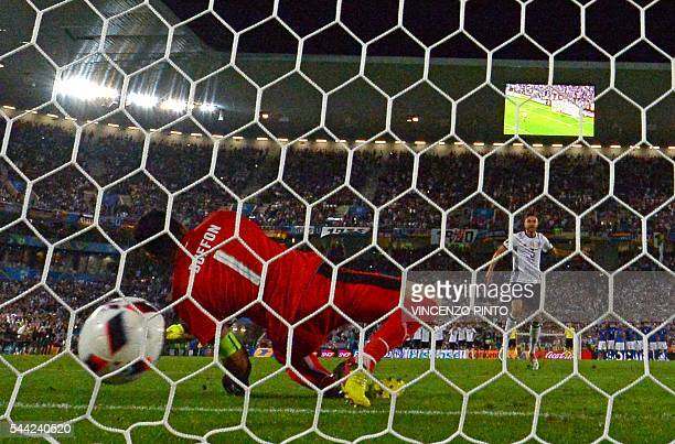 Italy's goalkeeper Gianluigi Buffon misses the ball as Germany's defender Jonas Hector to clinch the match for germany in a penalty shootout in the...