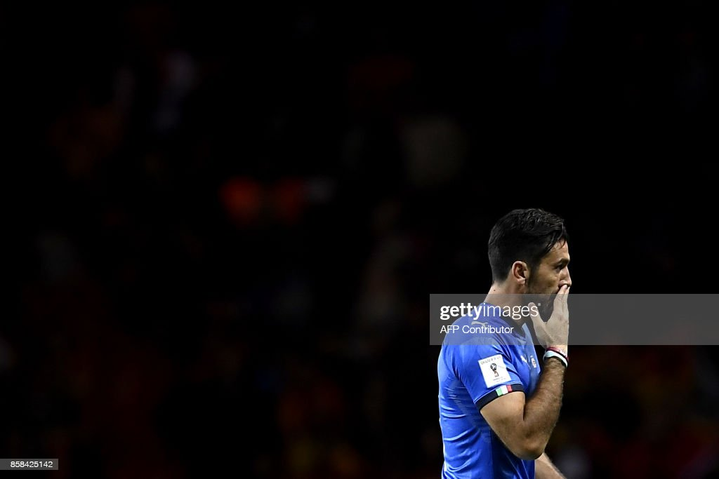 Italy's goalkeeper Gianluigi Buffon reacts at the end of the FIFA World Cup 2018 qualification football match between Italy and Macedonia at The 'Grande Torino Stadium' in Turin on October 6, 2017. /