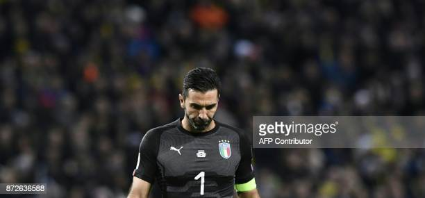 TOPSHOT Italy's goalkeeper Gianluigi Buffon reacts during the FIFA World Cup 2018 qualification football match between Sweden and Italy in...