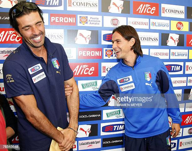 Italy's goalkeeper Gianluigi Buffon shares a joke with teammate striker Filippo Inzaghi during a press conference 06 September 2007 at the federal...