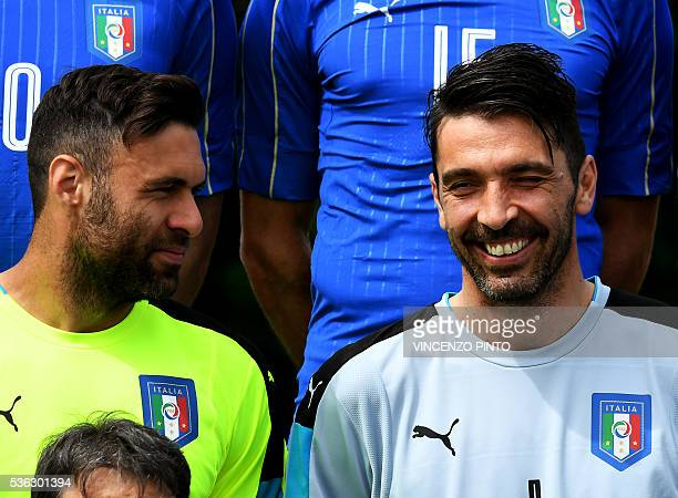 Italy's goalkeeper Gianluigi Buffon smiles next to Italy's goalkeeper Salvatore Sirigu during the official photo team prior to the Euro 2016...