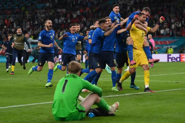 Italy's goalkeeper Gianluigi Donnarumma and teammates celebrate after winning the UEFA EURO 2020 final football match between Italy and England at...