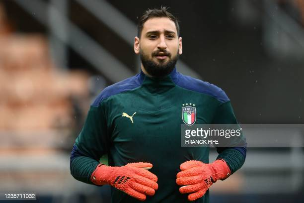 Italy's goalkeeper Gianluigi Donnarumma attends a training session on October 5, 2021 at the San Siro stadium in Milan, on the eve of their UEFA...