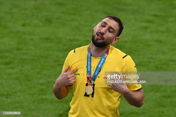Italy's goalkeeper Gianluigi Donnarumma gestures after Italy won the UEFA EURO 2020 final football match between Italy and England at the Wembley...