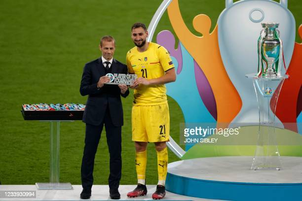 Italy's goalkeeper Gianluigi Donnarumma receives the player of the tournament trophy after Italy won the UEFA EURO 2020 final football match between...