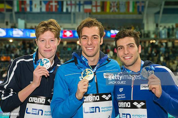 Italy's gold medalist Gregorio Paltrinieri his compatriot silver medalist Gabriele Detti and Norwegians bronze medalist Henrik Christiansen pose on...