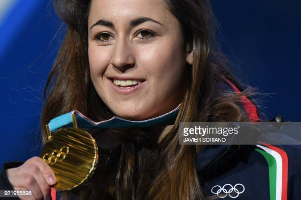 TOPSHOT Italy's gold medallist Sofia Goggia poses on the podium during the medal ceremony for the alpine skiing Women's Downhill at the Pyeongchang...