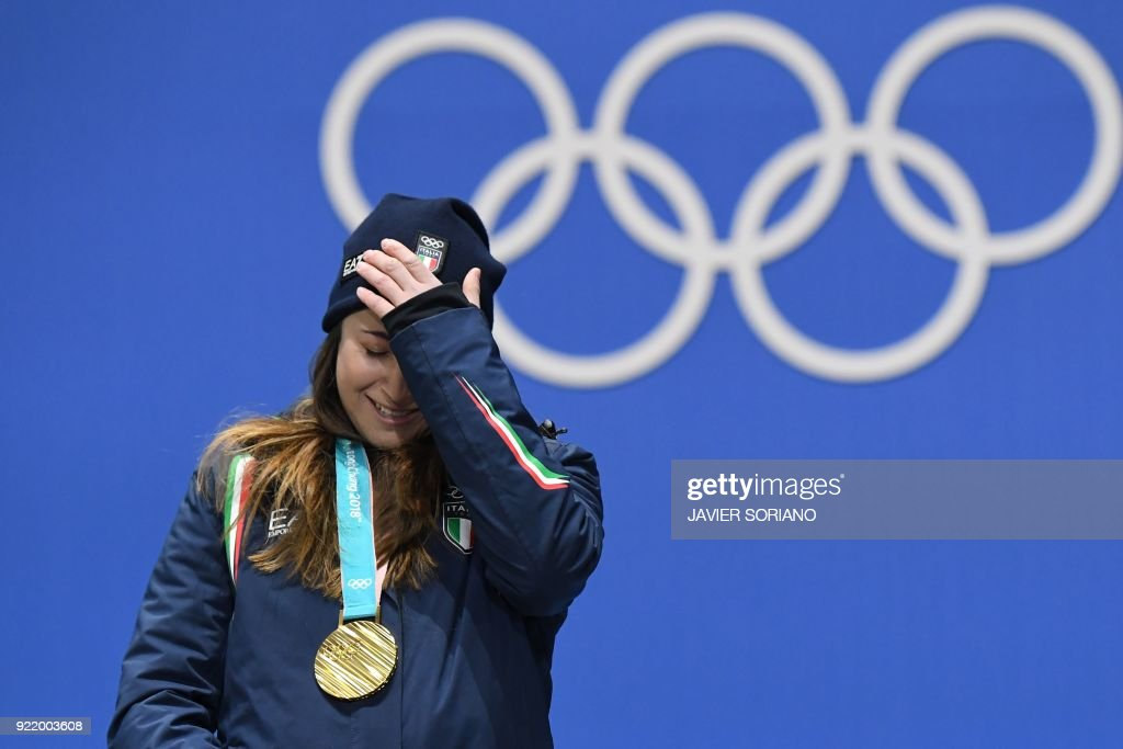 TOPSHOT - Italy's gold medallist Sofia Goggia reacts on the podium during the medal ceremony for the alpine skiing Women's Downhill at the Pyeongchang Medals Plaza during the Pyeongchang 2018 Winter Olympic Games in Pyeongchang on February 21, 2018. /