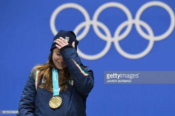 TOPSHOT Italy's gold medallist Sofia Goggia reacts on the podium during the medal ceremony for the alpine skiing Women's Downhill at the Pyeongchang...