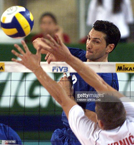 Italy's Gravina Pasquale hits the ball in front of Croatia's Inoslav Krnic during their Men's Volleyball World Championship match 29 September 2002...