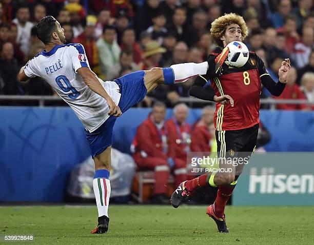 TOPSHOT Italy's Graziano Pelle challenges Belgium's midfielder Marouane Fellaini during the Euro 2016 group E football match between Belgium and...