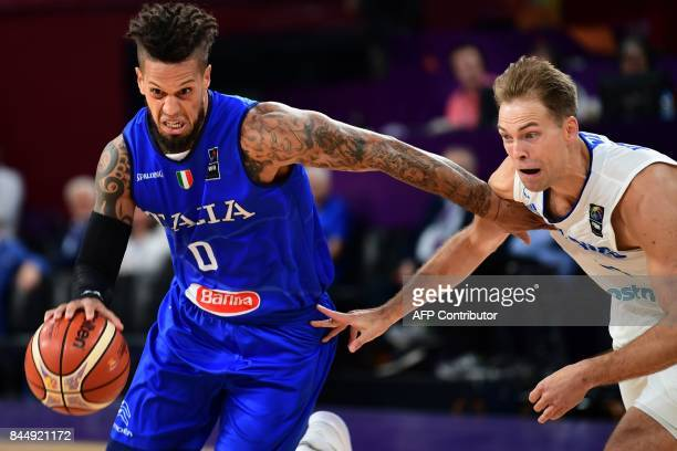 TOPSHOT Italy's guard Daniel Hackett vies with Finland's guard Petteri Koponen during their FIBA Eurobasket 2017 men's round 16 basketball match...