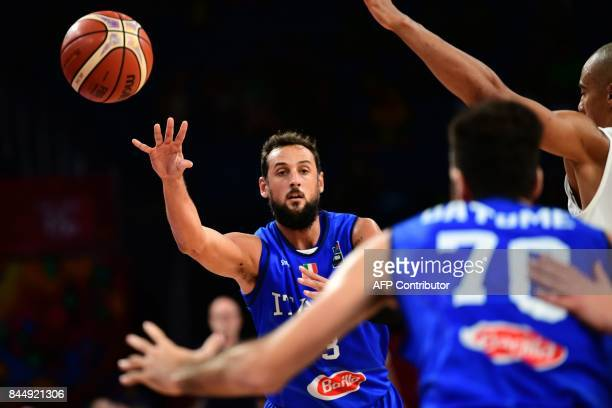 Italy's guard Marco Belinelli passes the ball during their FIBA Eurobasket 2017 men's round 16 basketball match between Finland and Italy at the...
