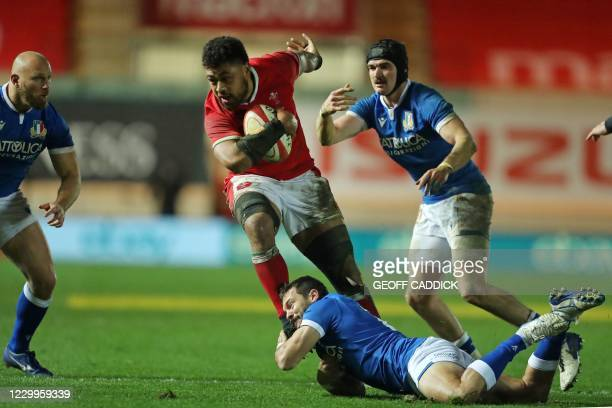 Italy's Guglielmo Palazzani tackles Wales' number 8 Taulupe Faletau during the Autumn Nations Cup international rugby union match between Wales and...