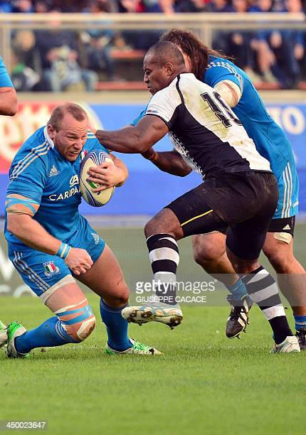 Italy's hooker Leonardo Ghiraldini fights for the ball with Fiji's flyhalf Seremaia Bai during the rugby test match between Italy and Fiji on...
