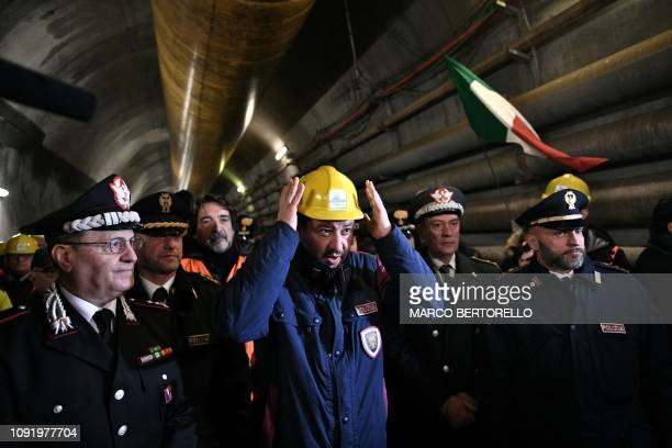 Italys Interior Minister and deputy PM Matteo Salvini adjusts his helmet during a visit to the building site of the TAV highspeed train line between...