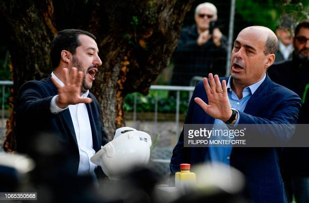 Italys Interior Minister and deputy PM Matteo Salvini and President of the Latium region Nicola Zingaretti gesture as they preside over the...