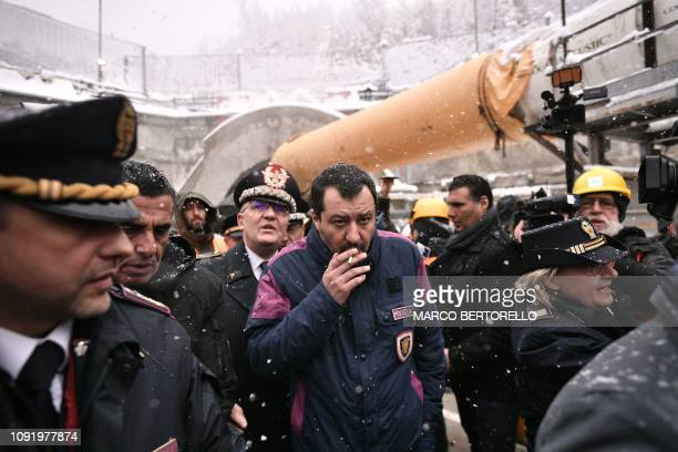 TOPSHOT Italys Interior Minister and deputy PM Matteo Salvini smokes a cigarette during a visit to the building site of the TAV highspeed train line...